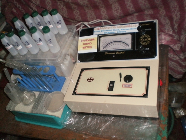 AYURVEDA URINOMETER machine, the first and only Urine Examination Technology developed by inventer and AYUSH Scientist Dr. Desh Bandhu Bajpai in AYURVEDA to Quantify the Status of Ayurvedic Principles and Disease Diagnosis and contents of the Urine , similar on the lines of AYURVEDA PATHOLOGY mentioned in Ayurvedic classical by AYURVEDA